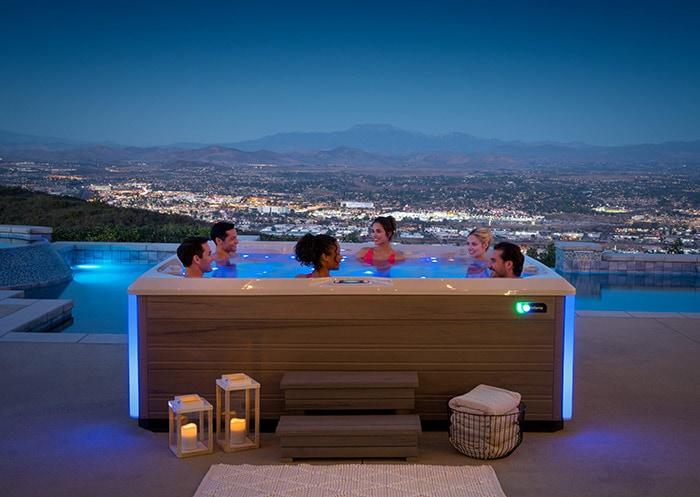friends enjoying prism hot tub