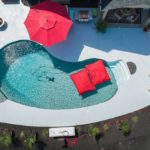 swimming pool with red umbrellas