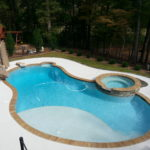 Pool with hot tub and slide